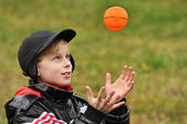 The boy plays a ball — Stock Photo