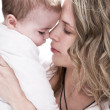 Young mother taking care about her child — Stock Photo #11899580