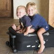 Young brother and sister together travel with bag — Stock Photo