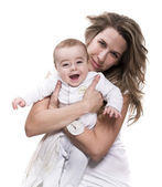 Young mother and jolly baby — Stock Photo