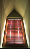 Dormer window with venetian blind — Stock Photo
