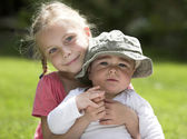 Young sister and brother outdoor — Stock Photo