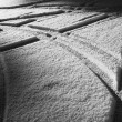 Vehicle tyre track in snow — Stock Photo