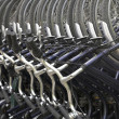 Stock Photo: Bicycle rental place, lots of blue bikes