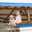 Kids sitting on a roof — Stock Photo
