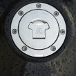 Wet black motorbike fuel cap - Stock Photo