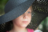 Little girl in a big hat — Stock Photo