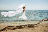 Beautiful woman runs at the beach — Stock Photo