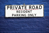 Private Road notice sign hang on blue brick wall — Stock Photo