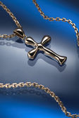 Golden cross and necklace jewelry — Zdjęcie stockowe