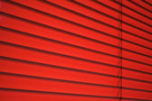 Red plastic venetian blind — Stock Photo