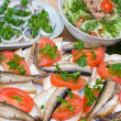Sandwiches with sprats on a plate — Stock Photo #10782695