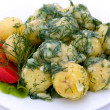 Potatoes and tomatoes with herbs — Stock Photo