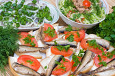 Sandwiches with sprats on a plate — Stock Photo