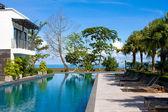 Swimming pool in luxury resort near the sea — Stock Photo