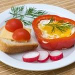 Eggs baked in pepper — Stock Photo