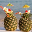 Two tropical cocktails on the beach — Stock Photo