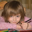 Little girl drawing with pencils — Stock fotografie