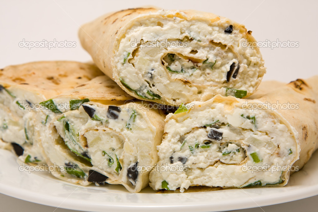 Pita bread wrapped with cottage cheese and vegetables  Stock Photo #10929581
