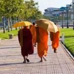 Cambodian monks walking on the street — Stock Photo #10956114