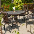 Royalty-Free Stock Photo: Table and chairs in a tropical garden
