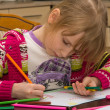 Little girl drawing with pencils — Stock Photo #11036850