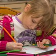 Little girl drawing with pencils - Stock Photo