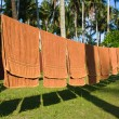 Fresh clean hotel towels drying on a line outdoors — Stock Photo