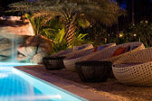 A pretty swimming pool in night at a local resort — Stock Photo
