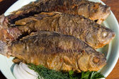 Fried fish crucian in plate — Stock Photo