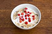 Muesli with yoghurt and wild strawberry — Stock Photo