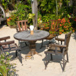 Table and chairs in tropical garden — Stock Photo #11222471