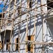 Wooden scaffolding around new building — Stock Photo #11329190