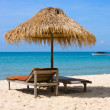 Stock Photo: Sun loungers with umbrella