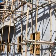 Wooden scaffolding around new building — Stock Photo #11392346