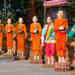 The image of monks in a Buddhist Temple - Stock Photo