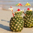 Stock Photo: Two tropical cocktails on the beach