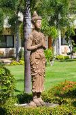 Buddha statue in zen garden — Stock Photo