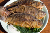 Fried fish carp in plate — Stock Photo