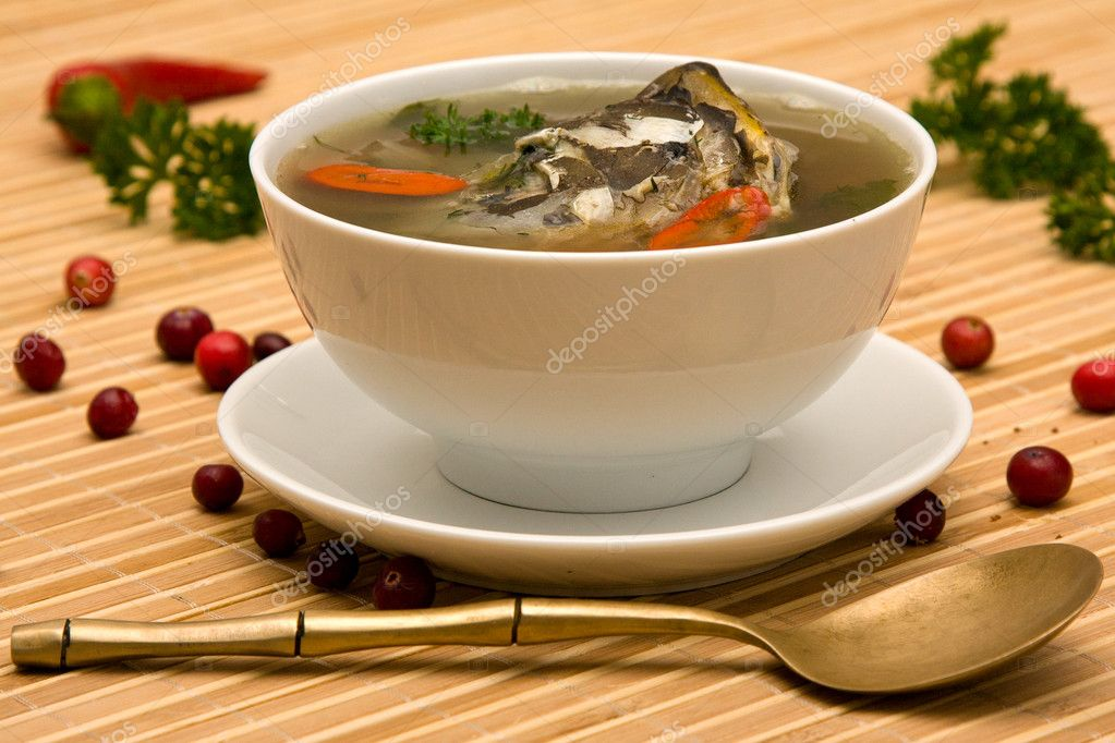 Delicious soup of the carp with potatoes, carrots and parsley — Stock Photo #11399891