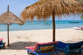 Sun loungers with an umbrella — Stock Photo