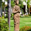Buddha statue in garden — Stock Photo