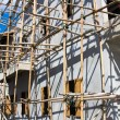 Wooden scaffolding around new building — Stock Photo #11505986