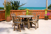 Table and chairs with a beautiful sea view . — Stock Photo