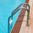 Swimming pool steps entrance — Stock Photo