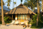 Beautiful tropical beach bungalow — Stock Photo