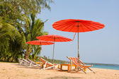 Sun loungers with an umbrella — Stock Photo
