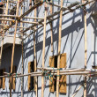 Wooden scaffolding around new building — Stock Photo #11790867