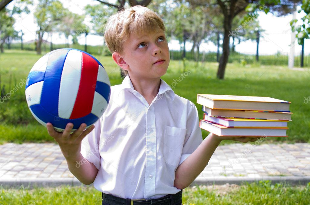 Boy holding a ball and a book — Stock Photo #10943721
