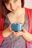Girl gives a gift — Stock Photo
